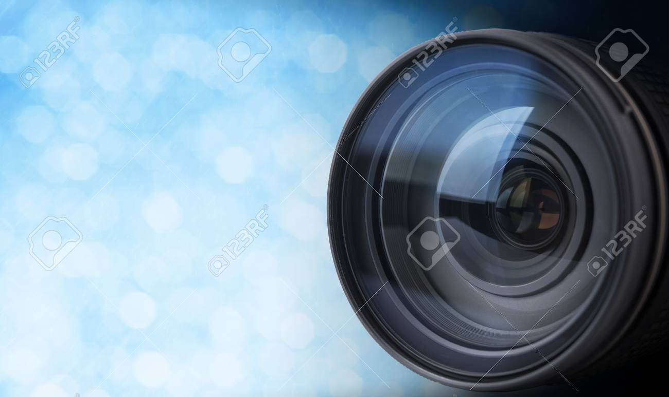 closeup camera lens with blurred bokeh light background