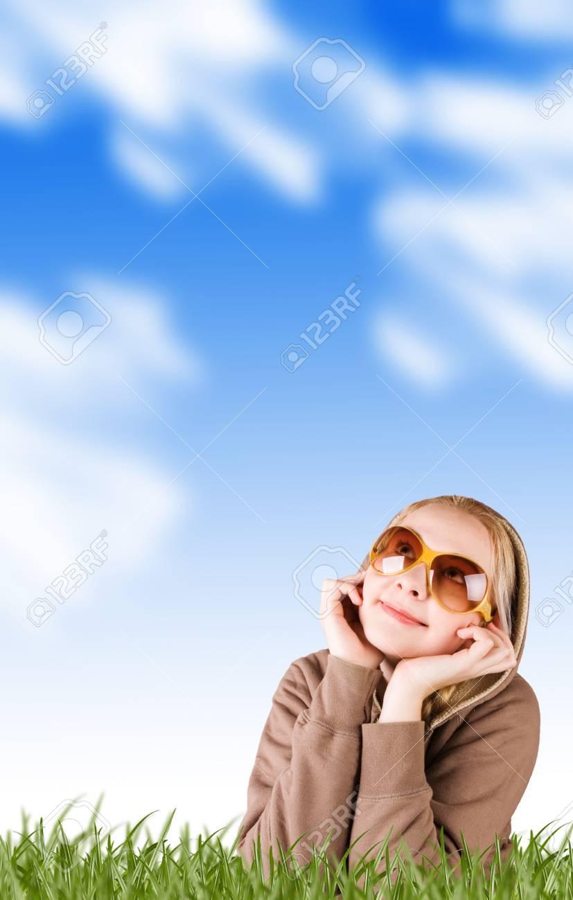 happy gorl lying in grass Stock Photo - 4189529