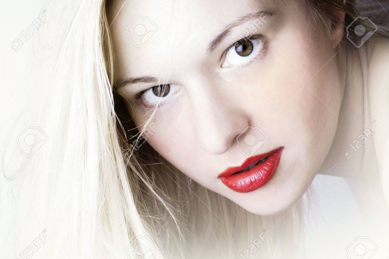 sensual female with red lips and soft white skin Stock Photo - 4517132
