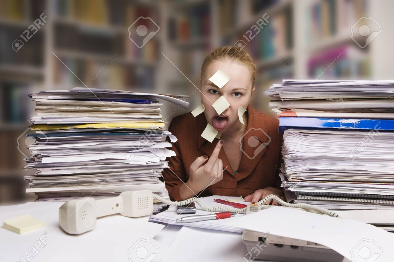 sick and tired businesswoman at the desk Stock Photo - 5022678