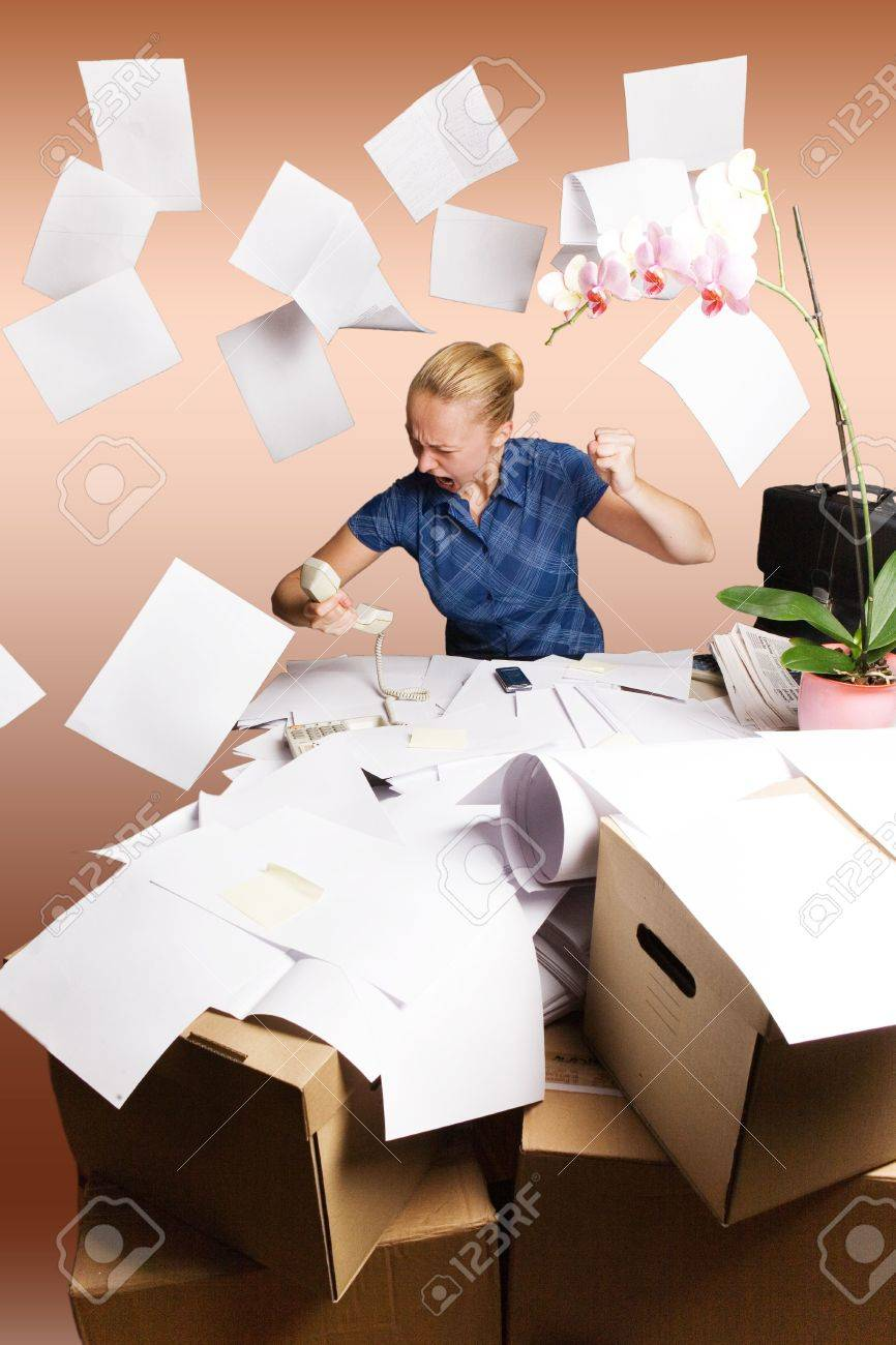 Businesswoman In Her Office And Flying Paper Sheets Stock Photo ...