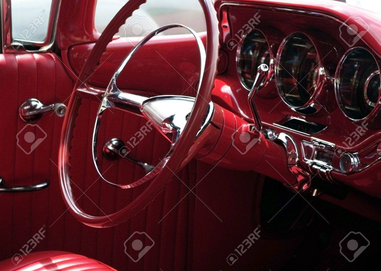 Red 1950u0027s Classic Car Interior, With Steering Wheel And Instrument Panel  (focus On Steering
