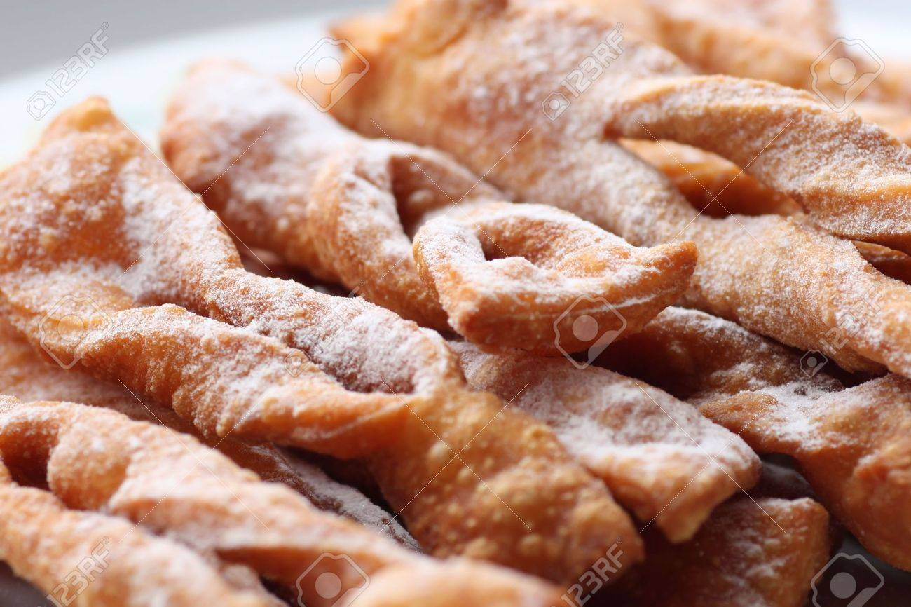Chrust (faworek) - Polish fried cookie (a kind of cracknels) with powdered sugar Stock Photo - 4354288