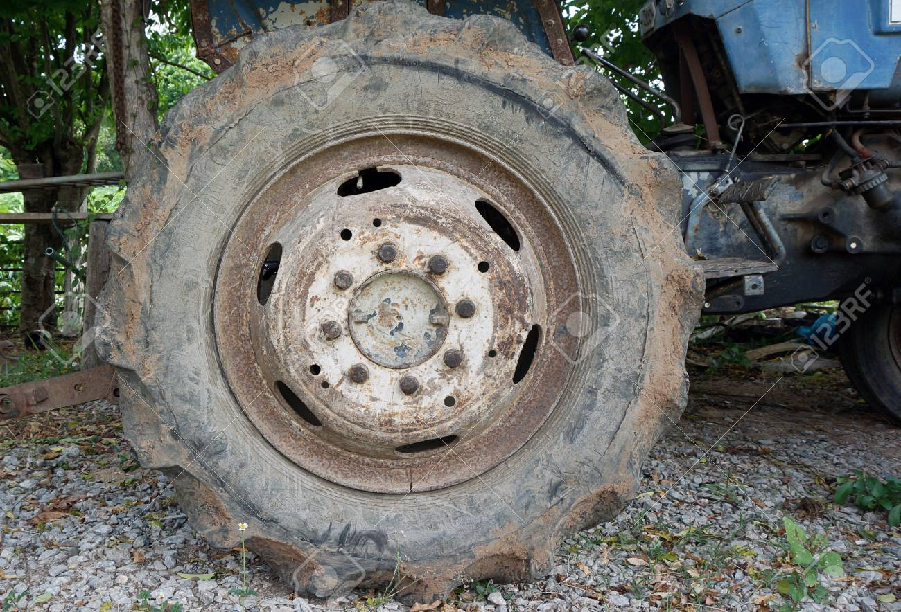 Dirty old wheel of tractor stock photo picture and royalty free dirty old wheel of tractor stock photo 46621260 publicscrutiny Choice Image