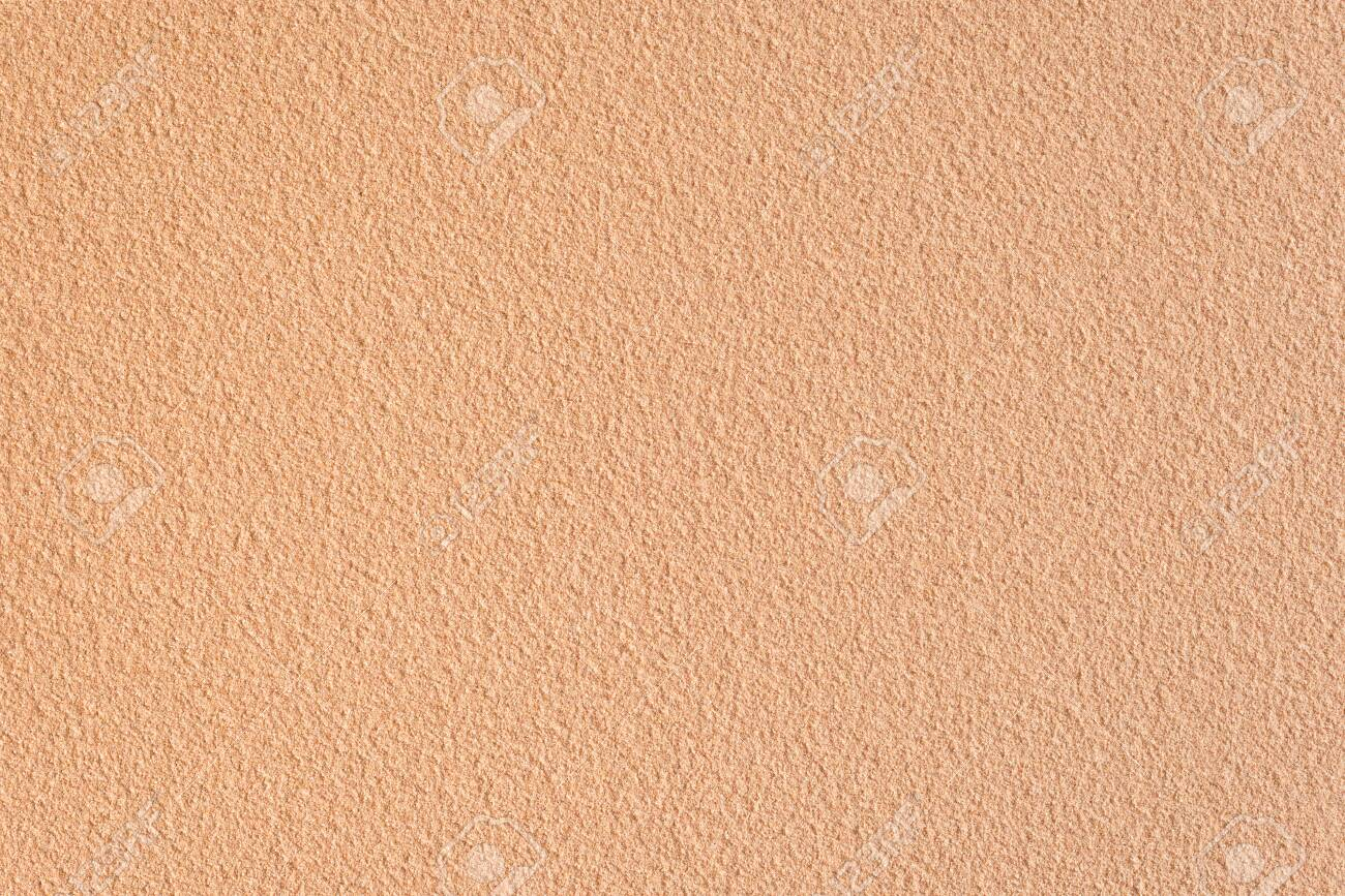 Textured sand background closeup. Decorative wall plaster, interior decoration. Background image of a wall with a beige textured coating. - 149452471