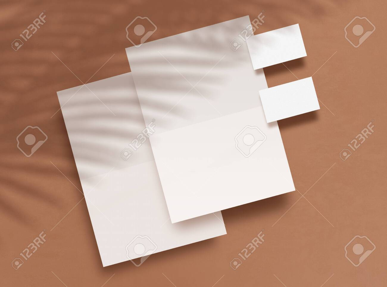 Top view of blank forms and business cards on a brown background. Shadows overlays from tropical plants. Empty objects to place your design. Corporate identity Branding Mock up. 3D illustration. - 149452585