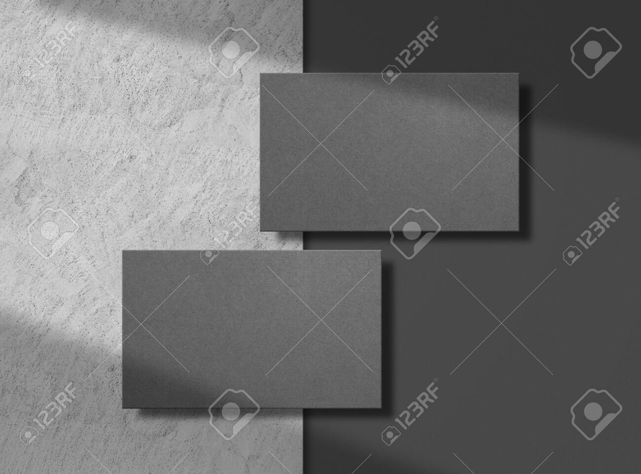 Two black business cards on concrete background. Mock up. Template for corporate identity. Empty objects to place your design. Top view. Illustration. - 149594195