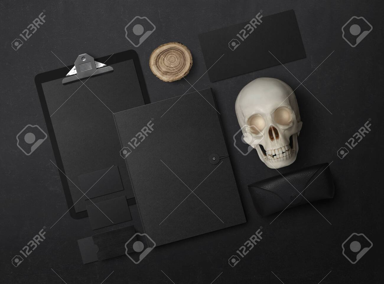 Mock-up. Template for branding identity. Blank objects for placing your design. Sheets of paper, business cards and envelope. Skull 3d illustration - 149685003