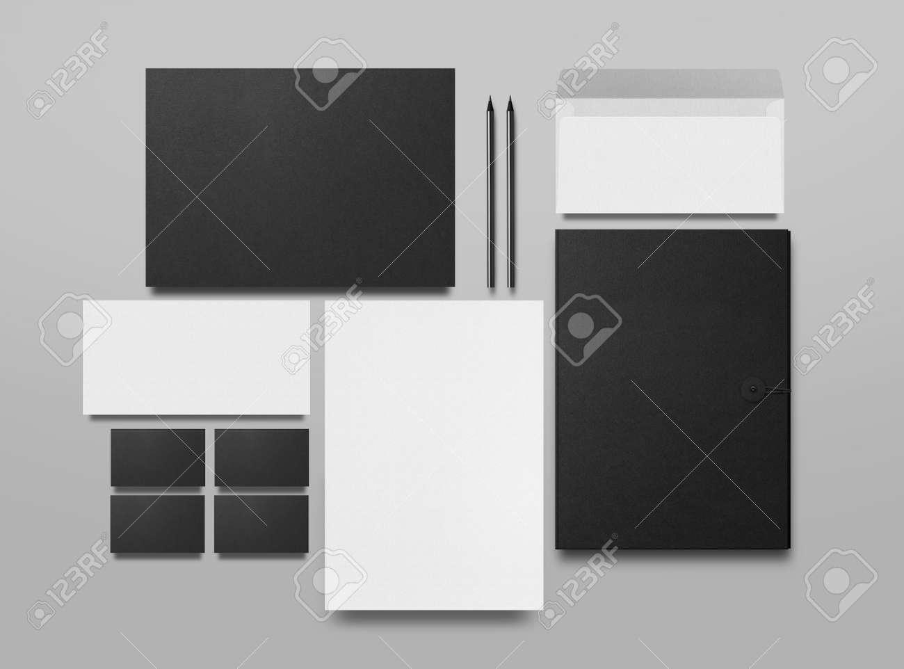 Mock up. Set of mock up elements on gray background. Blank objects for placing your design. Black folder, a sheet of paper, an envelope, a black business card and pencils. 3d illustration. - 150177831