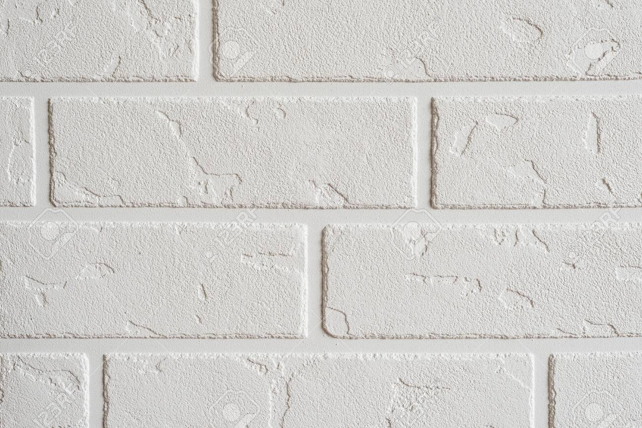 Textured white background. Decorative concrete coating imitating a brick wall. Textured wall plaster, exterior facade. - 152170018