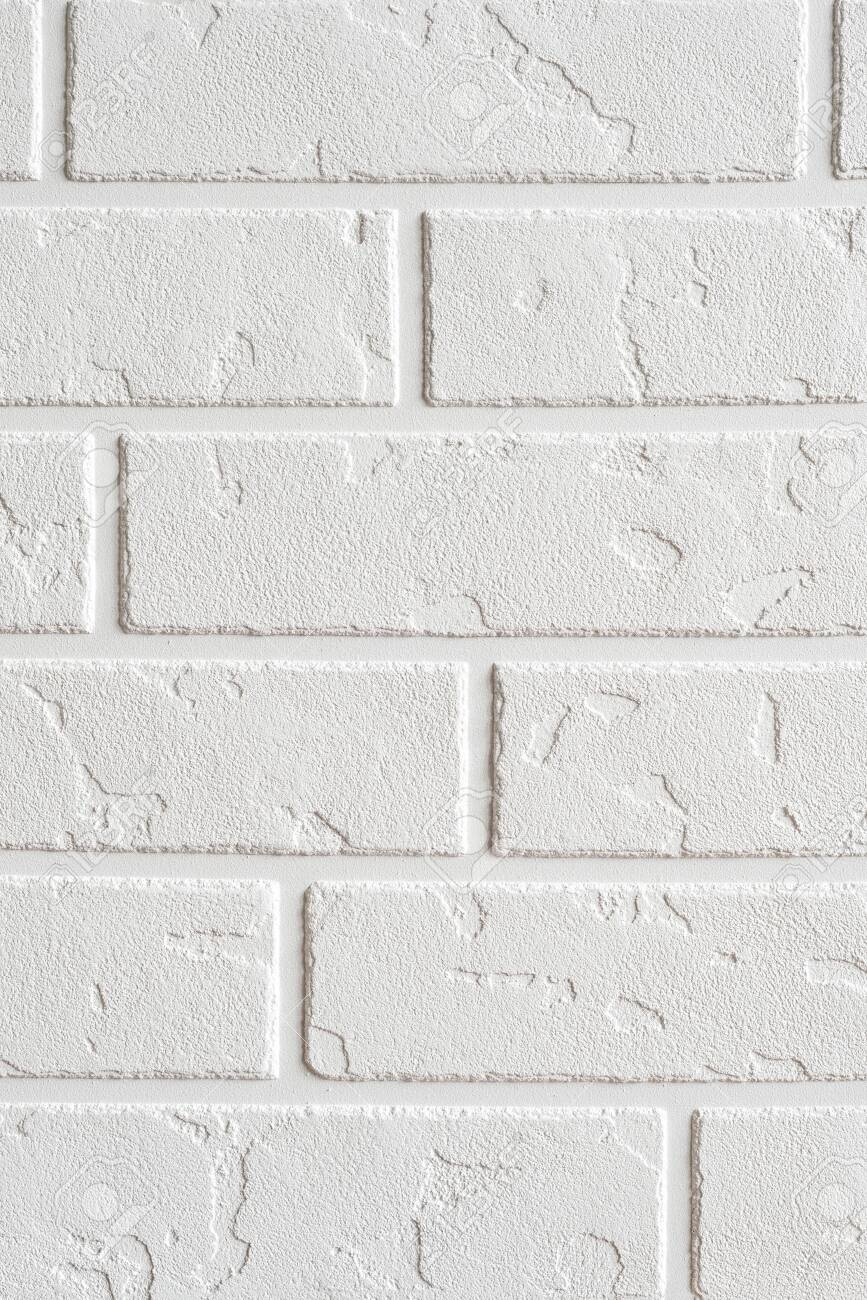 Textured white background vertical. Decorative concrete coating imitating a brick wall. Textured wall plaster, exterior facade. - 152170233