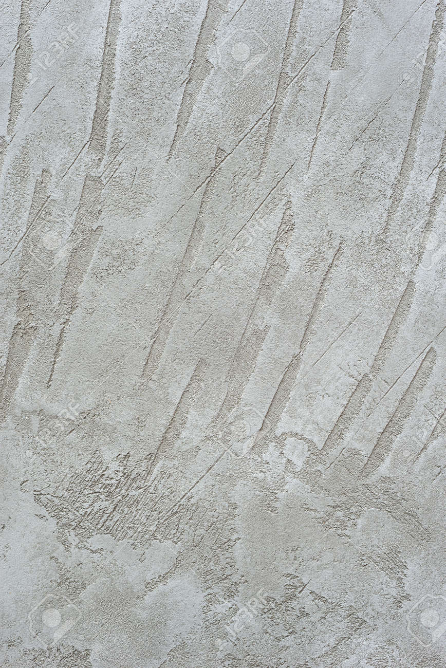 Textured vertical background. Decorative gray plaster imitating an old concrete wall. Exterior cement facade finish. - 152170003