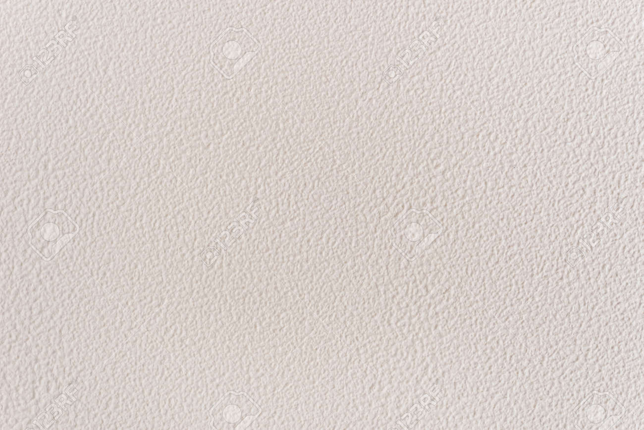 Textured background with decorative light stucco. Close-up image of a wall. Exterior finish of the facade with a rough coating. - 152267966