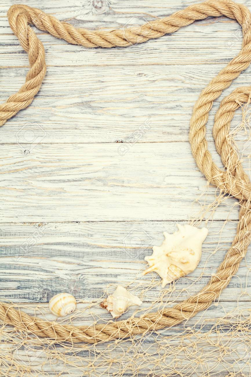 Seashell and rope on a light wooden background - 96366030