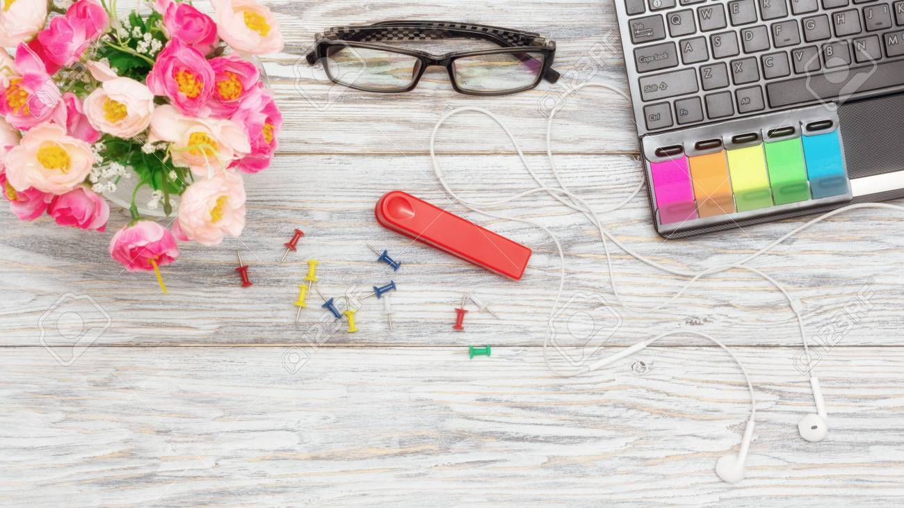 workplace: laptop, glasses and flowers - 111271659