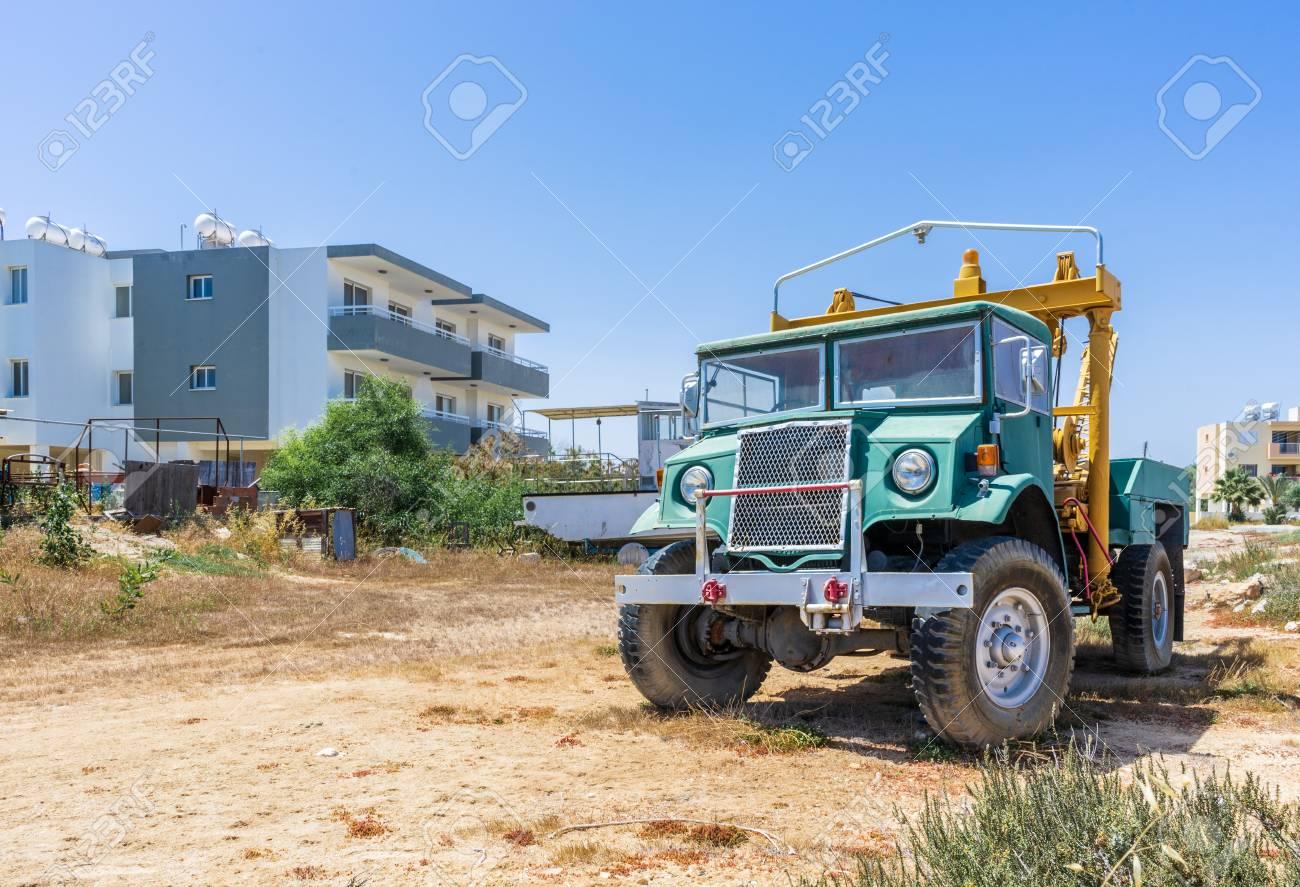 Old blue truck on blue sky background - 113495035