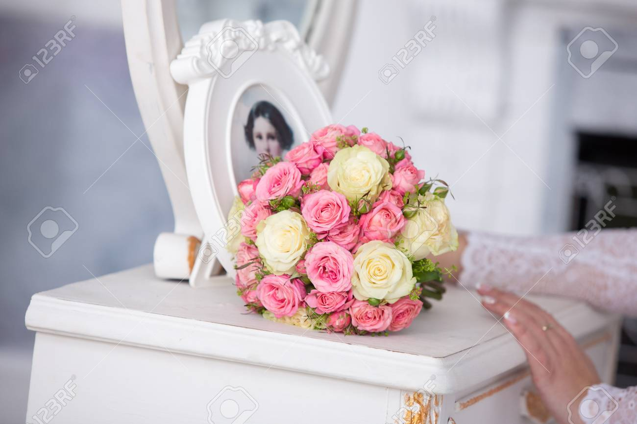 Bridal Bouquet From Roses Of Pink Color On A White Dressing Table ...