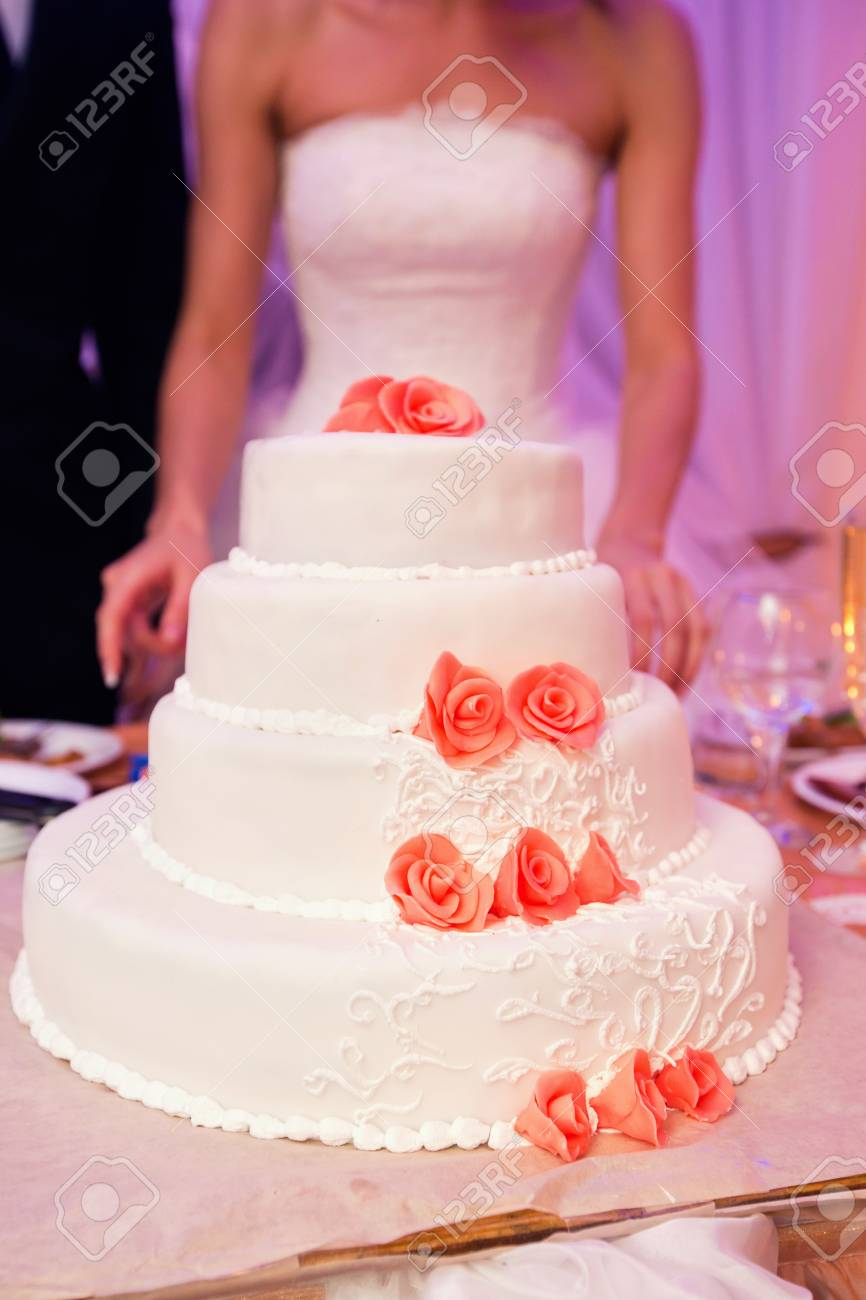 White Wedding Cake And Pink Details Stock Photo, Picture And Royalty ...