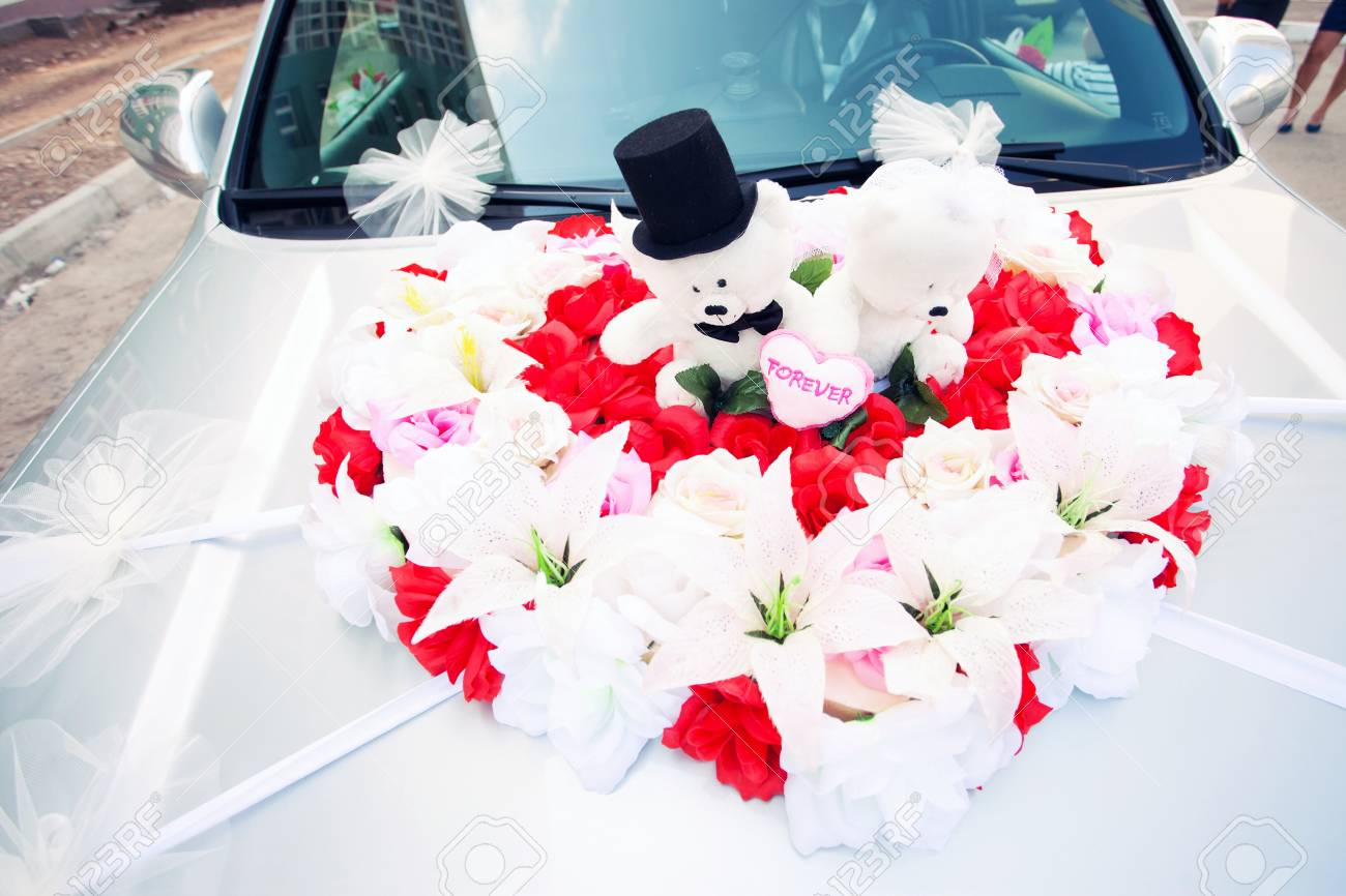 Red And White Decoration Of The Wedding Car Bears Stock Photo ...