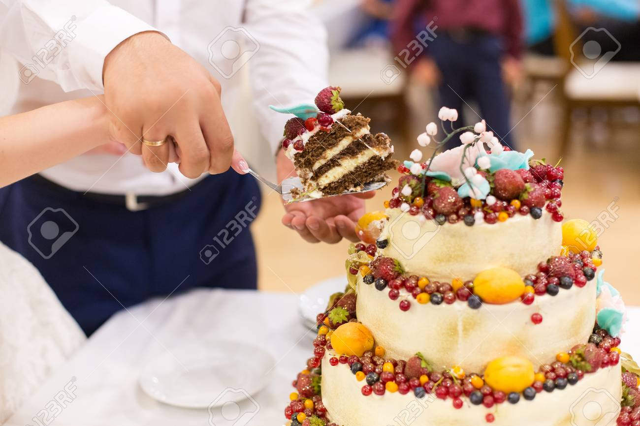Newlyweds Cut Wedding Cake With Fruit Stock Photo Picture And