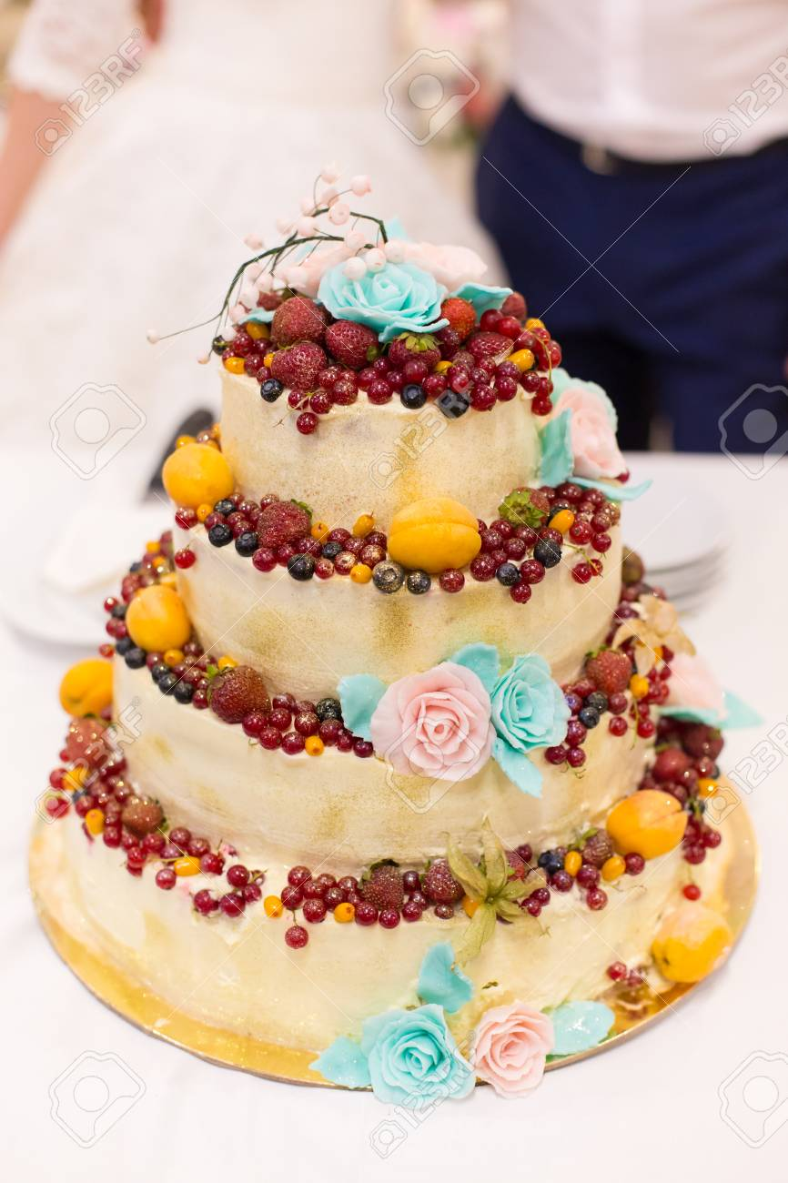 Newlyweds Cut Wedding Cake With Fruit Stock Photo, Picture And ...