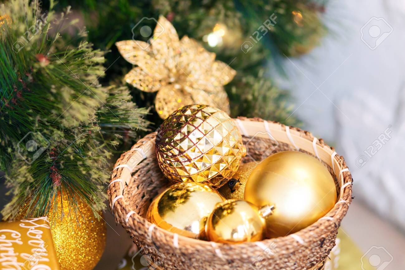 Close Up Of A Christmas Tree And Decoration With Gold Ball On ...