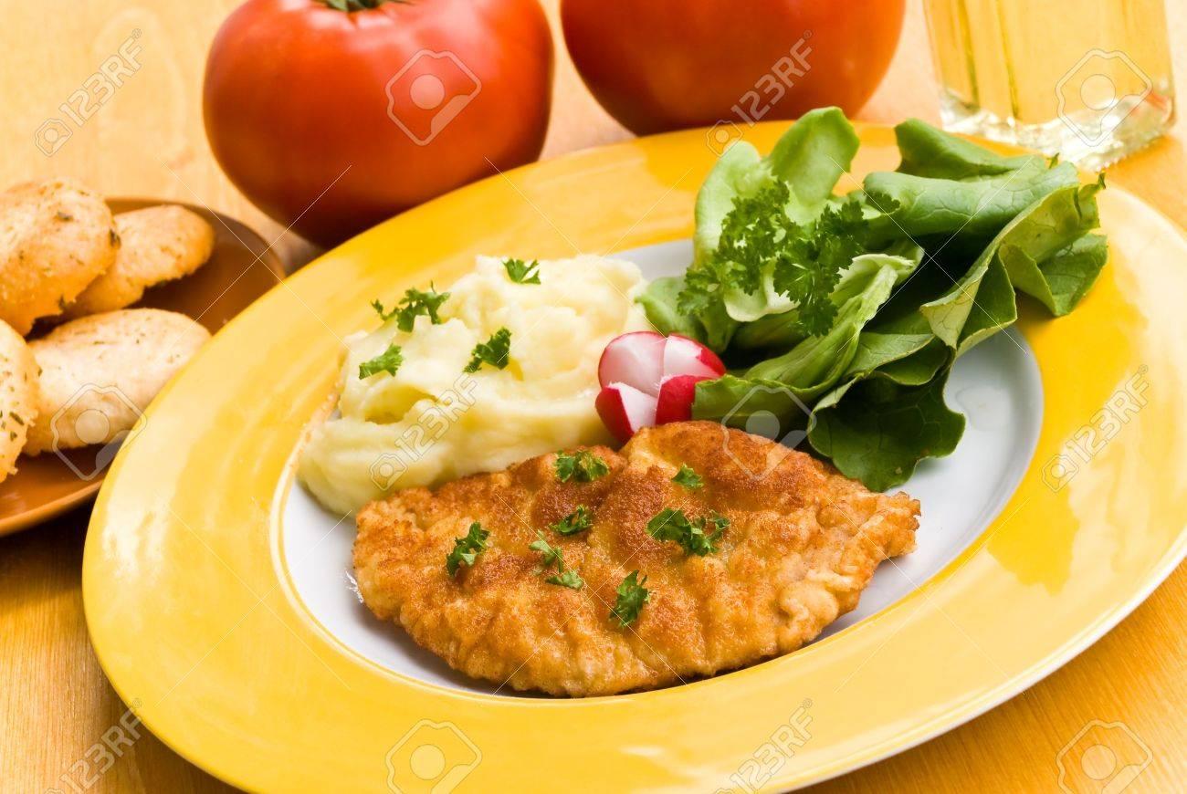 pork cutlet with green salad and puree,tomato,radish Stock Photo - 3290261
