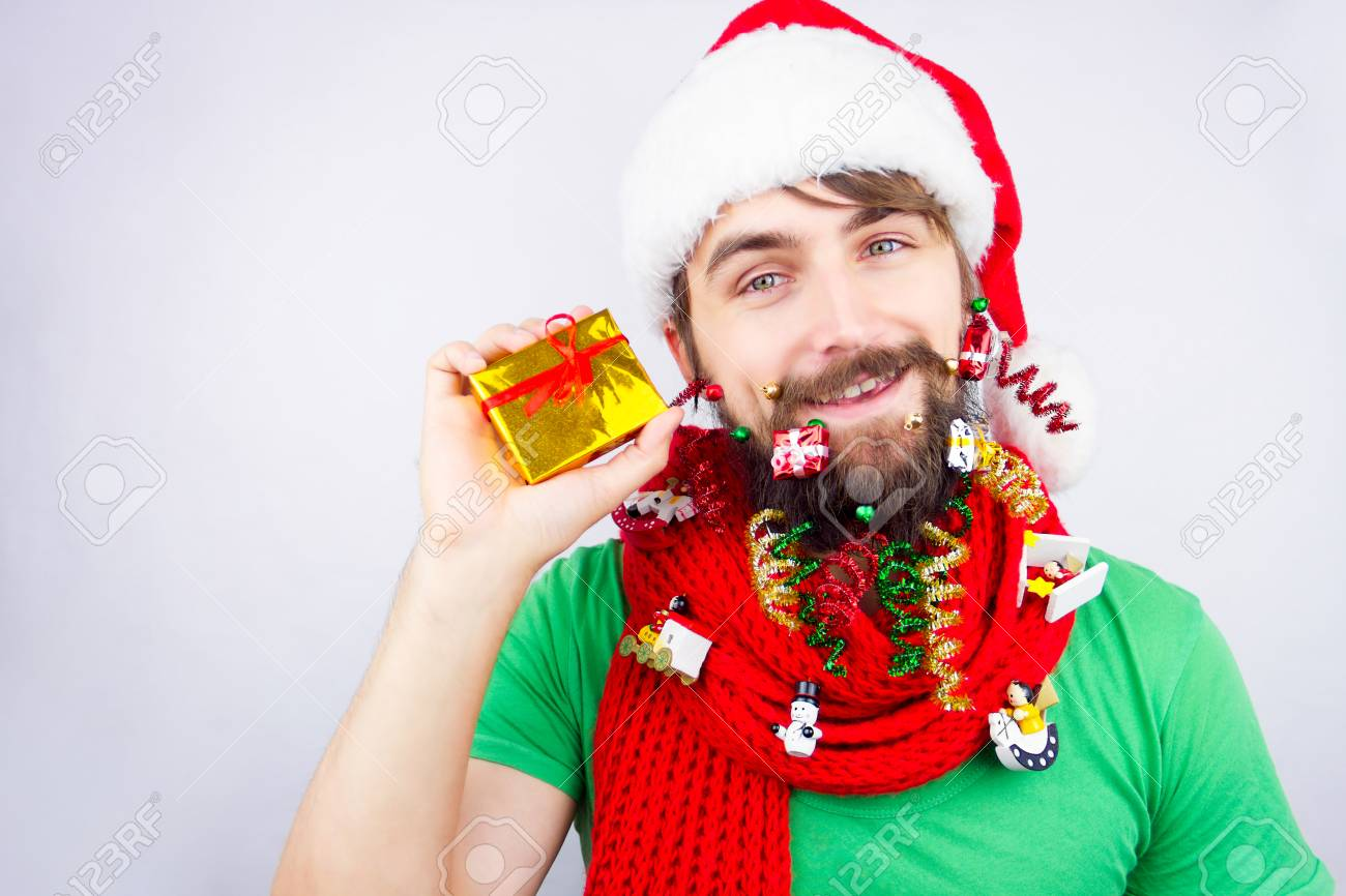 Christmas Beard.Guy Dressed As Santa Wearing Beard Decorated With Colorful Christmas