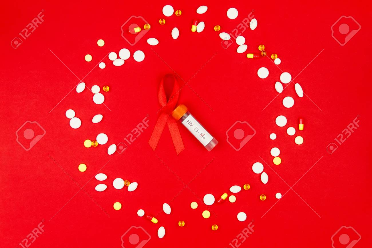Red Tape As Symbol Of Aids Hiv Illness With Blood In Test Tubes