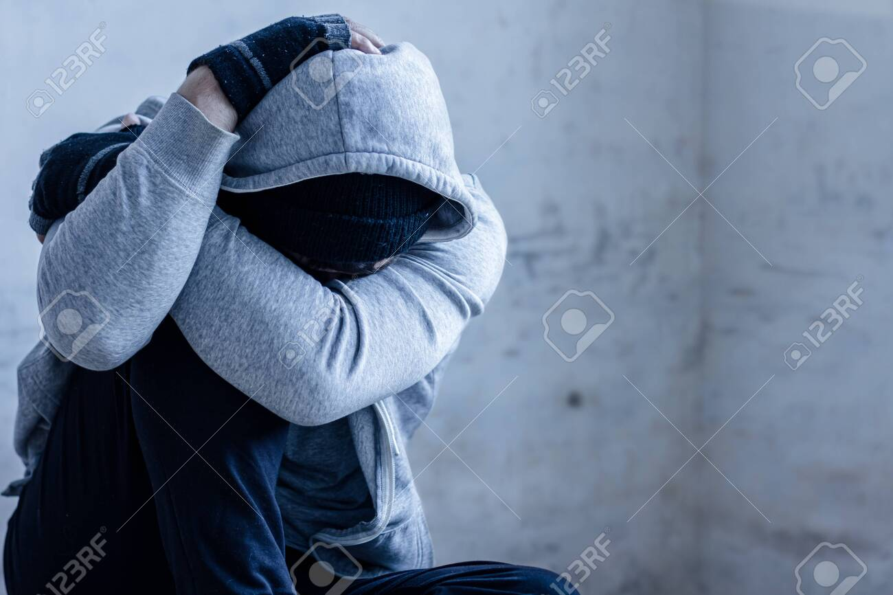 Unhappy Guy In Hood Is Sitting On Floor In Abandoned Building Stock Photo Picture And Royalty Free Image Image 138469536