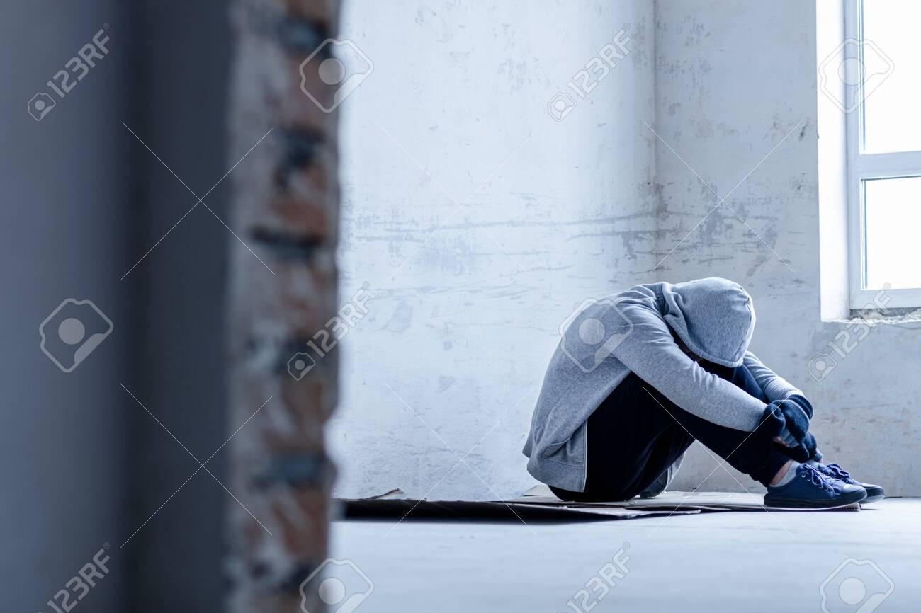 Unhappy Guy In Hood Is Sitting On Cardboard On Floor In Abandoned Stock Photo Picture And Royalty Free Image Image 138469546