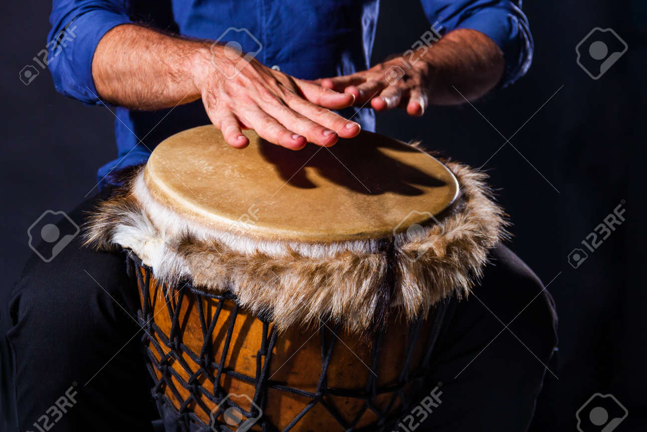 Percussion musical instruments and culture concept. Closeup male musicians hands are playing with turkish darbuka, african indian jembe drum. Summer festival concert performance. Ethnic rhythm. - 173236085