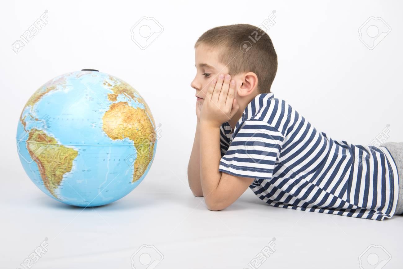 World map globe and boy in sailor shirt stock photo picture and stock photo world map globe and boy in sailor shirt gumiabroncs Images