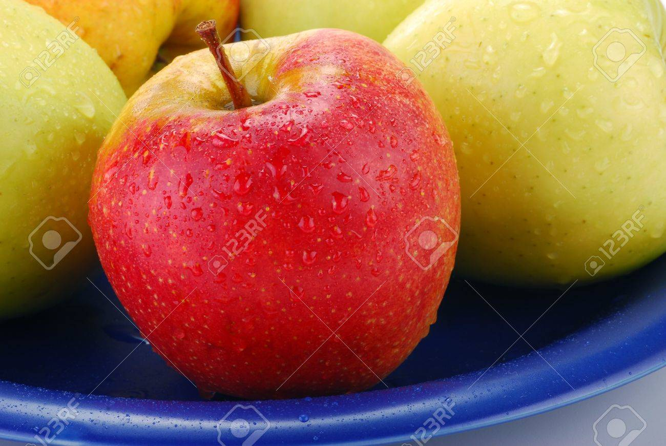 Apples on blue plate Stock Photo - 8912884