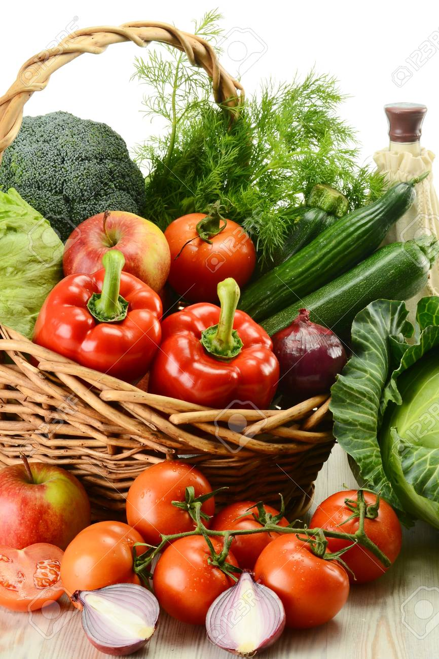 Composition with raw vegetables and wicker basket Stock Photo - 9110247