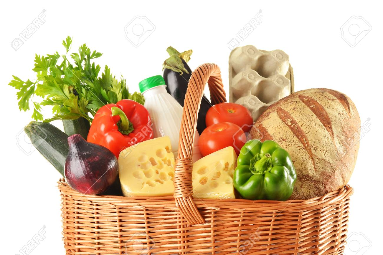 Groceries in wicker basket isolated on white Stock Photo - 10081564