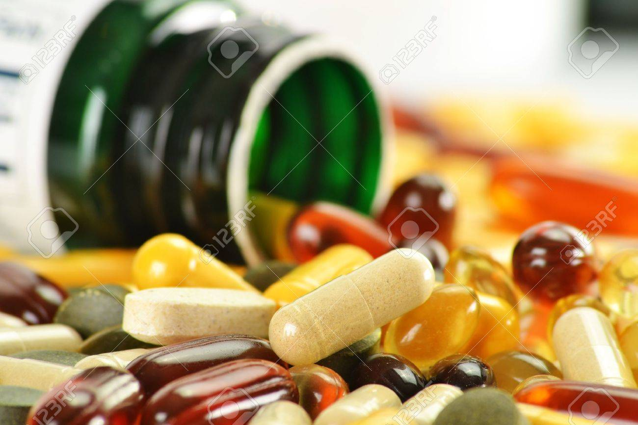 Composition with dietary supplement capsules and containers. Variety of drug pills Stock Photo - 10081563