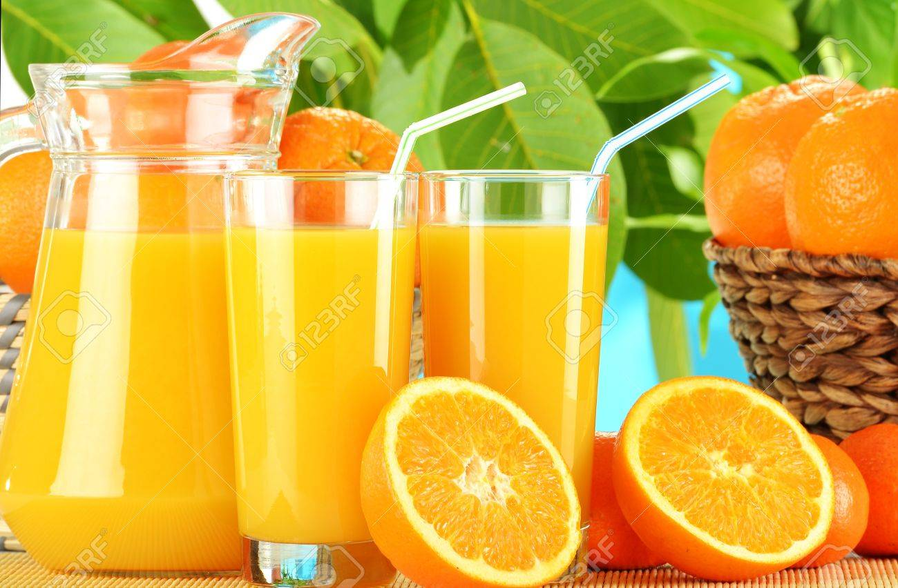 Composition with two glasses of orange juice and fruits Stock Photo - 10481943