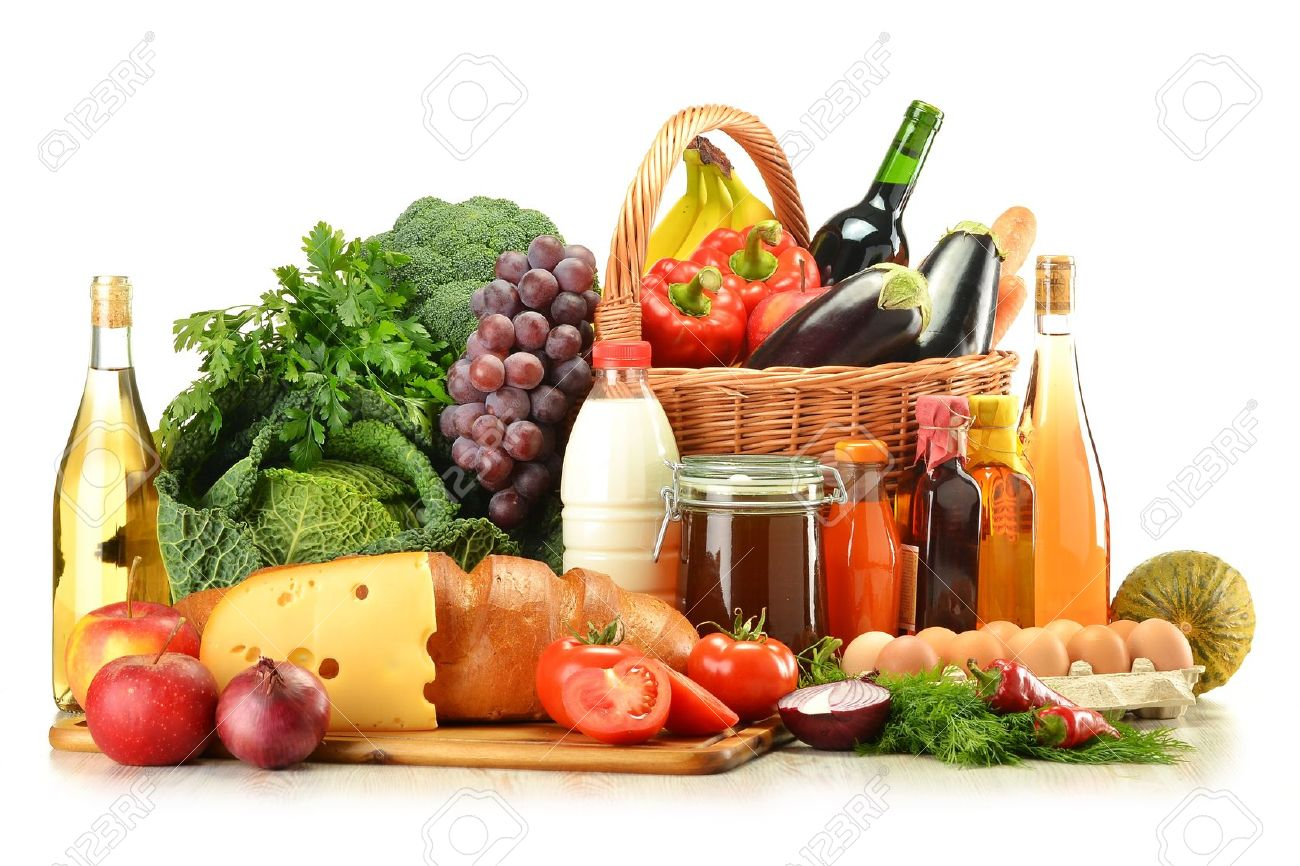 Groceries in wicker basket including vegetables, fruits, bakery and dairy products and wine isolated on white Stock Photo - 10788257