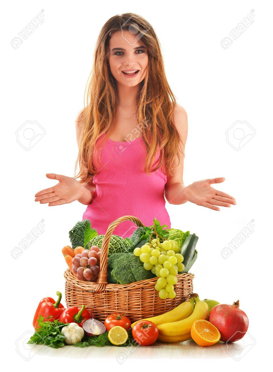 Young attractive woman with variety of fresh vegetables and fruits isolated on white Stock Photo - 12457411
