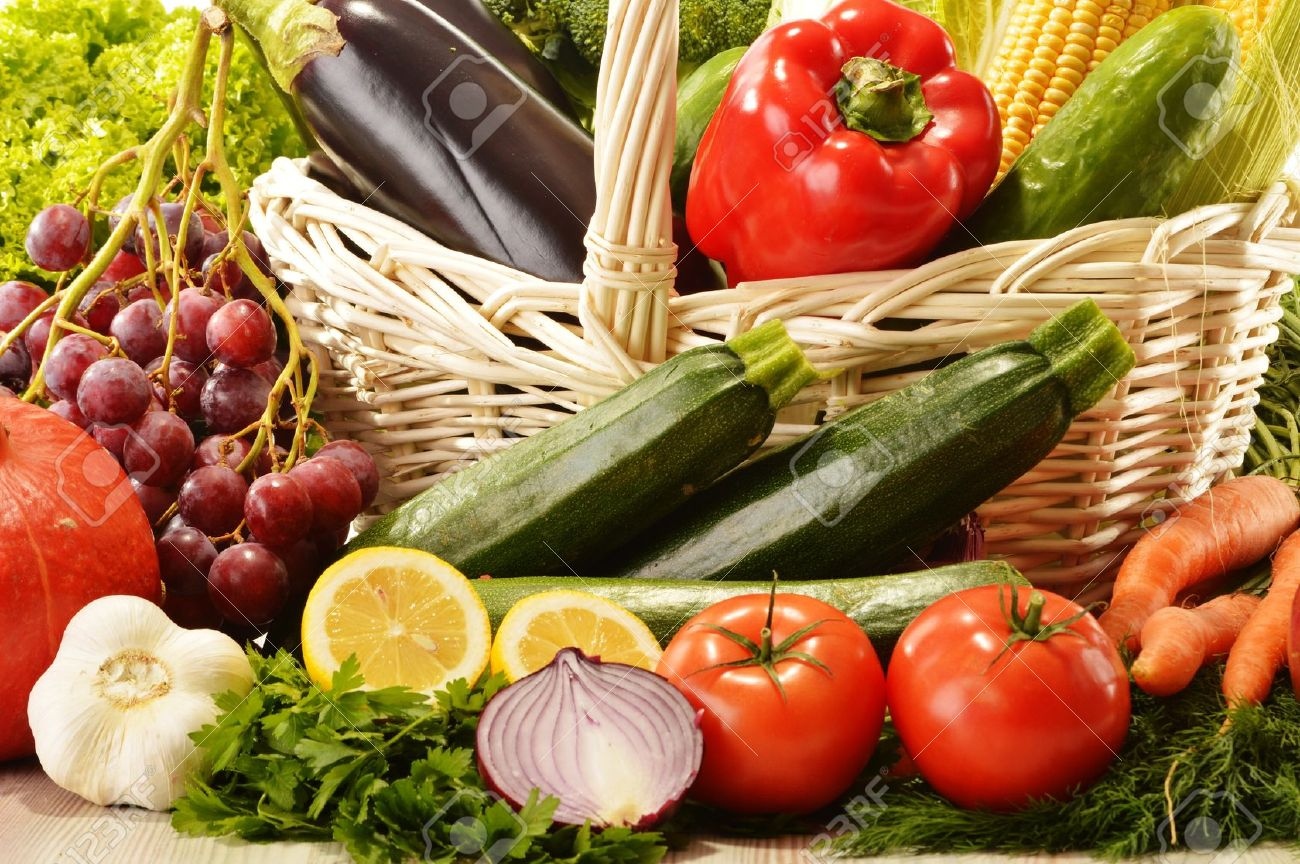 Charming Fruits And Vegetables In Wicker Basket Stock Photo   16314086