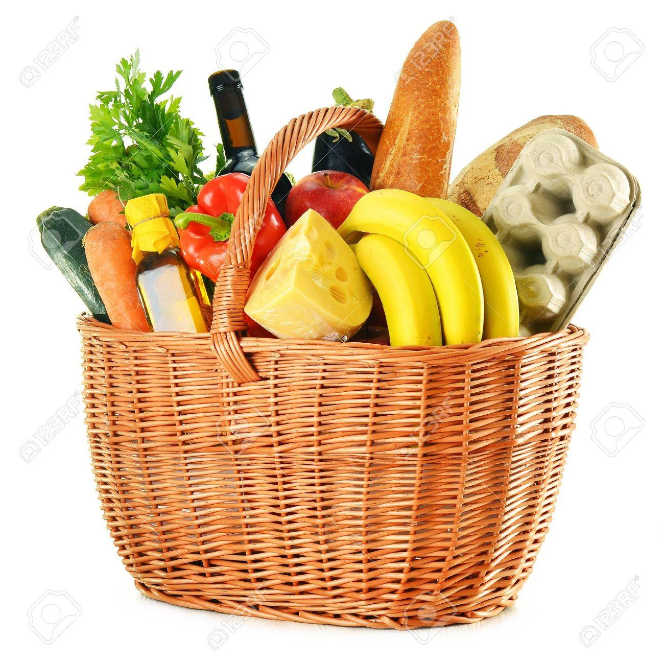 Wicker basket with variety of grocery products isolated on white - 18755462