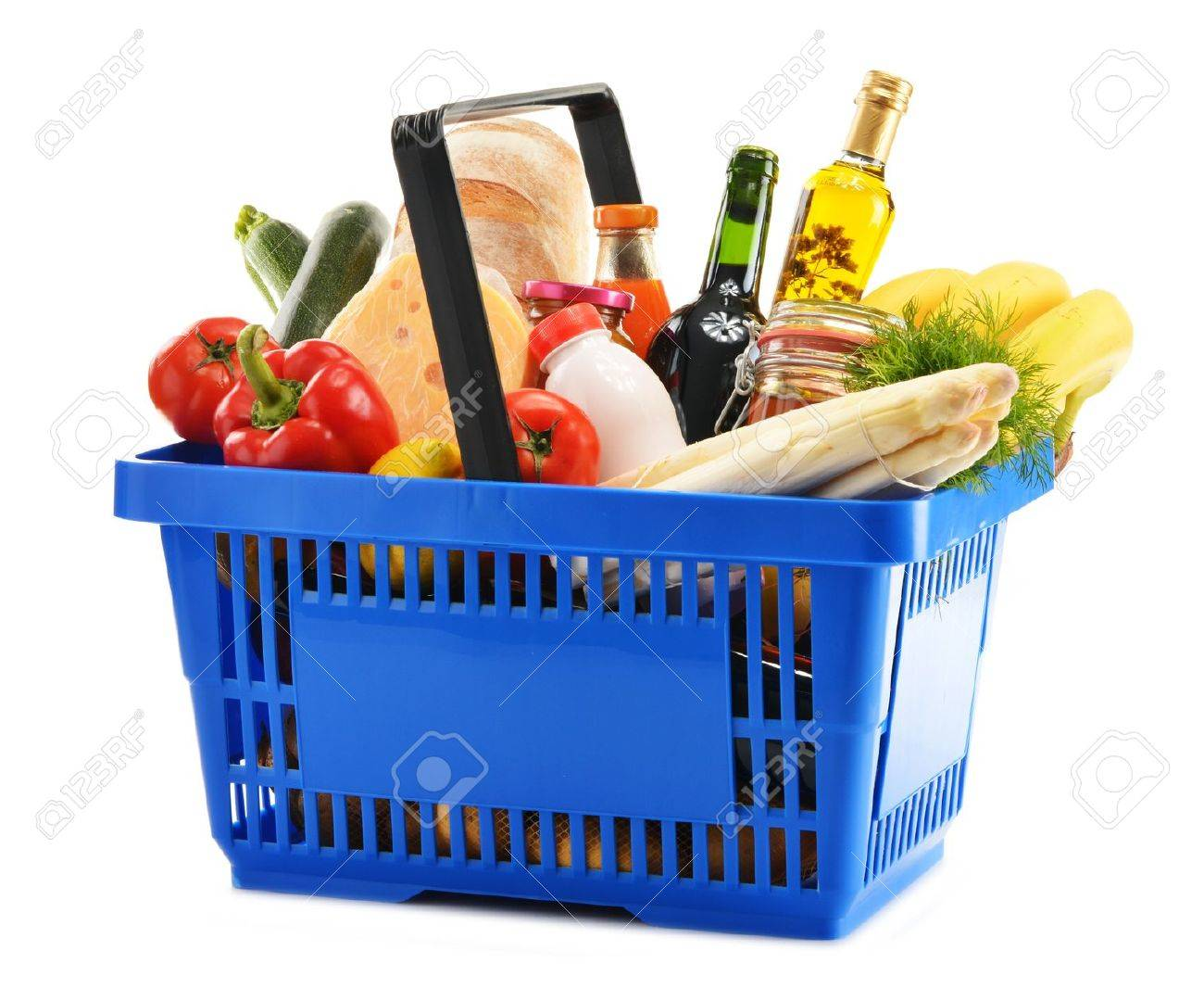 Plastic shopping basket with variety of grocery products isolated on white - 20329976
