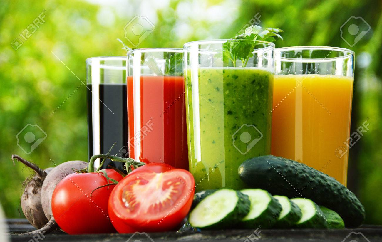 Glasses with fresh vegetable juices in the garden Detox diet - 30405438