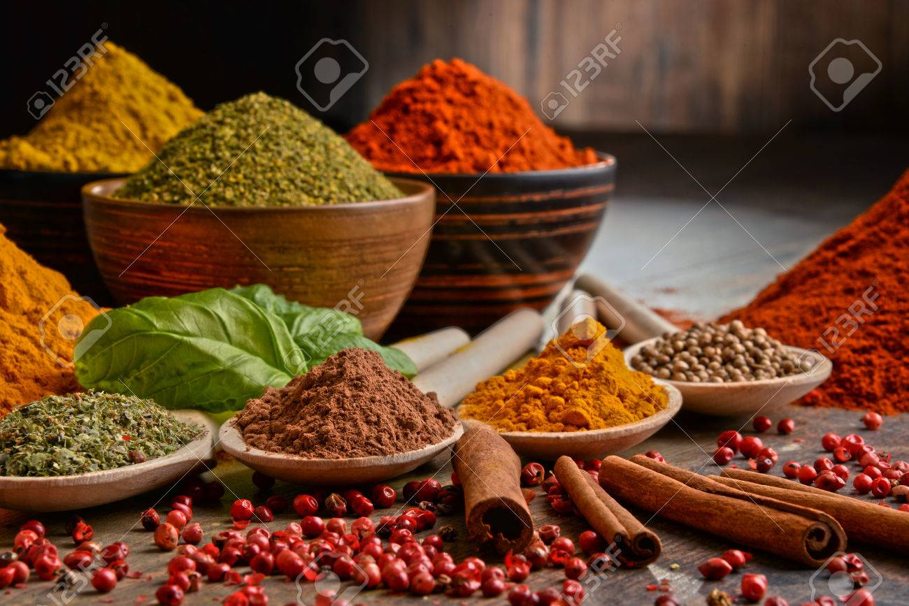 Variety of spices on kitchen table. - 52142548