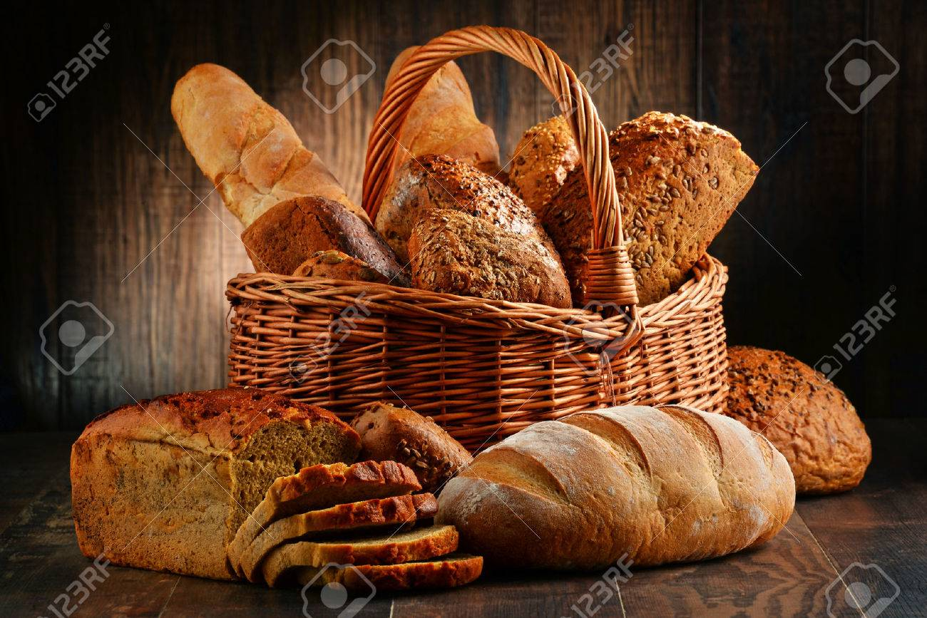 Composition with variety of baking products on wooden table - 54345222