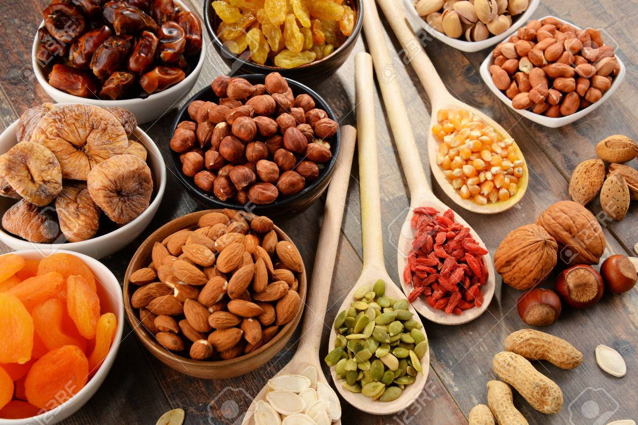 Composition with dried fruits and assorted nuts. - 54344635