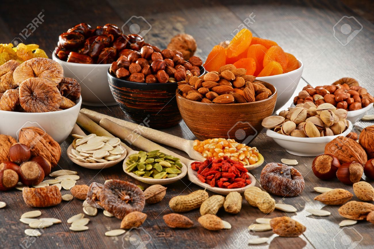 Composition with dried fruits and assorted nuts. - 54344630