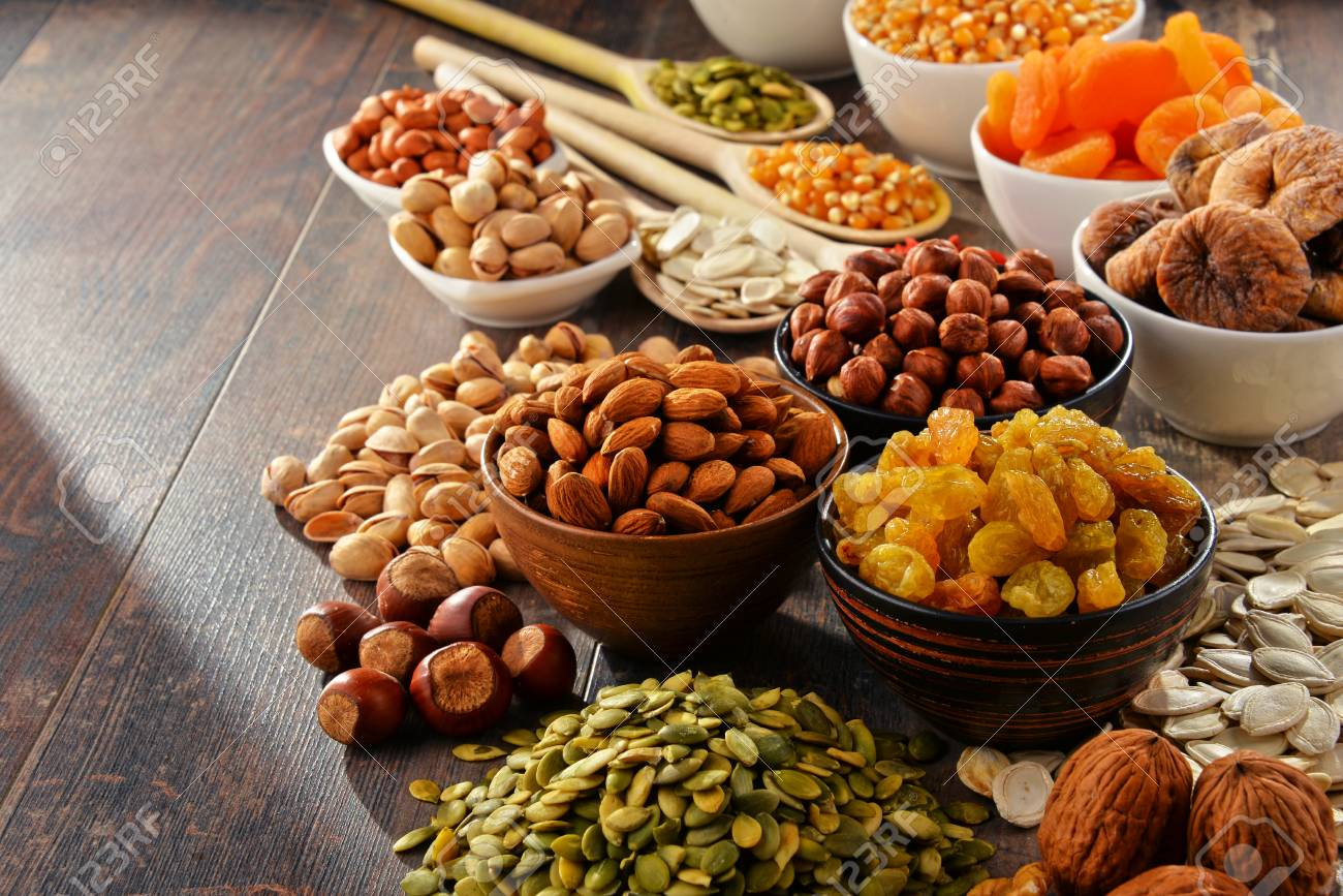 Composition with dried fruits and assorted nuts. - 54344639