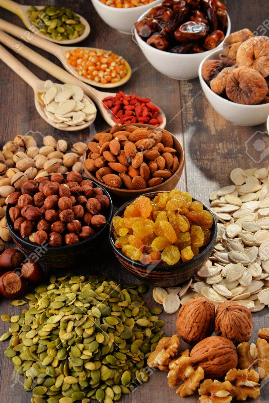 Composition with dried fruits and assorted nuts. - 54344520